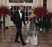 Misty Copeland, Principal Dancer, American Ballet Theatre and Olubayo Evans arrive at the State Dinner for China's President President Xi and Madame Peng Liyuan at the White House in Washington, DC for an official State Visit Friday, September 25, 2015. Credit: Chris Kleponis / CNP