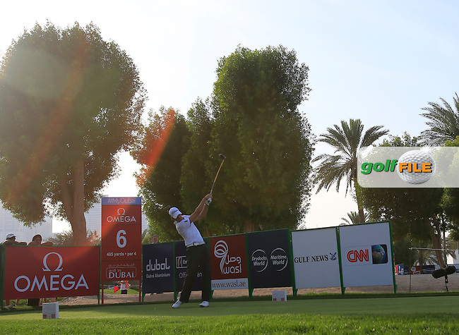 Simon Thornton (IRL) tees off the 6th tee during Thursday's Round 1 of the Omega Dubai Desert Classic 2014 held at the Emirates Golf Club, Dubai. 30th January 2014.<br /> Picture: Eoin Clarke www.golffile.ie