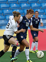US's Alex Morgan fights for the ball with Germany's Josephine Henning during their Algarve Women's Cup soccer match at Algarve stadium in Faro, March 13, 2013.  .Paulo Cordeiro/ISI