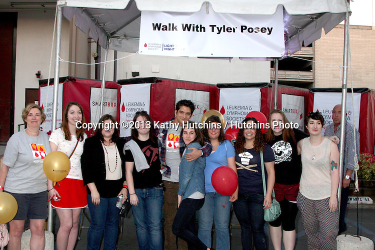 LOS ANGELES - OCT 6:  Tyler Posey with fans and supporters of his LLS team at the Light The Night The Walk to benefit the Leukemia-Lymphoma Society at Sunset-Gower Studios on October 6, 2013 in Los Angeles, CA