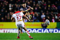 Picture by Alex Whitehead/SWpix.com - 16/03/2018 - Rugby League - Betfred Super League - St Helens v Leeds Rhinos - Totally Wicked Stadium, St Helens, England - Leeds' Joel Moon is tackled by St Helens' Dominique Peyroux after he kicks the ball.