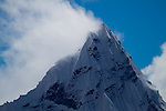 Snow and clouds spin of the summit of Mt. Ama Dablam as seen from the summit of 20,075 foot Mt. Lobuche.