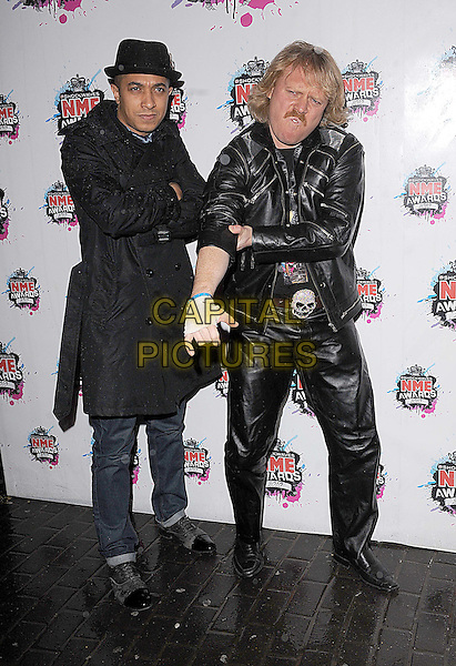 JADE JONES & LEIGH FRANCIS.The Shockwaves NME Awards 2010 held at Brixton Academy, London, England..February 24th, 2010.full length black hat jacket leather trenchcoat trench coat arms crossed hand arm rolling up sleeve funny white glove.CAP/BEL.©Tom Belcher/Capital Pictures.