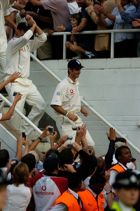 Photo: Glyn Thomas..England v Australia. nPower Test Series. The Ashes 2005..12/09/2005..England's captain Michael Vaughan leads his team out to be presented with the Ashes.