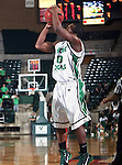 North Texas Mean Green guard Josh White (10) goes up for a jumpshot in the game between the Texas State Bobcats and the University of North Texas Mean Green at the North Texas Coliseum,the Super Pit, in Denton, Texas. UNT defeated Texas State 85 to 62