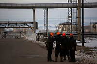 Workers are seen at a Bashneft oil refinery in Ufa, Bashkortostan, Russia. The area is a major oil and gas producing region in the country.