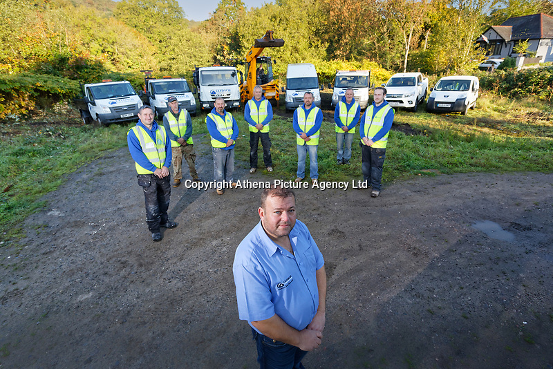 Pictured: Michael Sykes with the his staff and the fleet of vehicles owned by his company. Wednesday 11 October 2018 <br /> Re: Clydach Construction in Clydach, south Wales, UK.