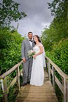Bride and Groom on Rustic Bridge at Three Lakes