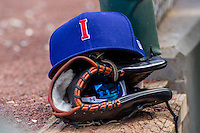 An Iowa Cubs hat sits atop a glove on the dugout steps during a game against the Colorado Springs Sky Sox on September 4, 2016 at Principal Park in Des Moines, Iowa. Iowa defeated Colorado Springs 5-1. (Brad Krause/Four Seam Images)