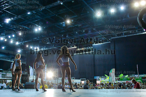 Competitors pose for the jury in their fitness dresses during the Miss Zsaru (Miss Cop) contest in Budapest, Hungary on May 13, 2012. ATTILA VOLGYI