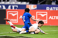 9th February 20020, Stade de France, Paris, France; 6-Nations international mens rugby union, France versus Italy;  The try is scored by Baptiste Serin ( France ) despite the tackle from Carlo Canna ( Italy )
