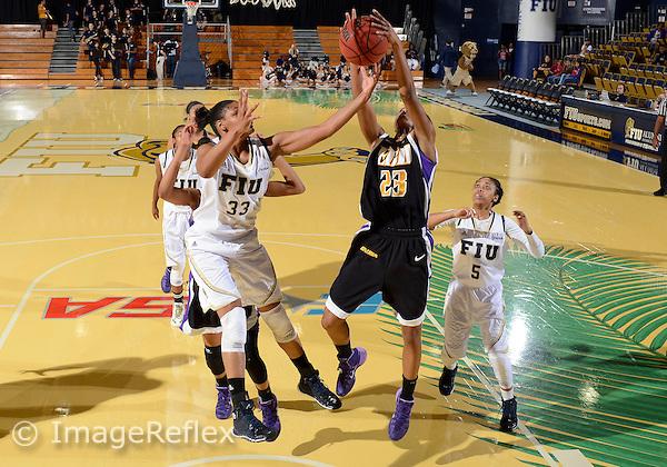 Florida International University forward/center Brianna Wright (33) plays against East Carolina University. FIU won the game 76-75 in overtime on January 11, 2014 at Miami, Florida.