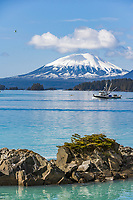 Commercial fishing boat cape purse seiner, passes by Mount Edgecumbe, Sitka Sound, southeast, Alaska