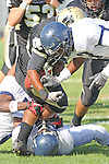 Palos Verdes CA 10/22/10 - Okuoma Idah (Peninsula #24) and Irahan Avilla (Leuzinger #7) in action during the Leuzinger - Peninsula varsity football game at Palos Verdes Peninsula High School.