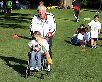 "Thomas Rongen with a participant during a  D.C United clinic in support of first lady Michelle Obama's ""Let's Move"" initiative on the White House lawn, in Washington D.C. on October 7 2010."