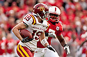 24 October 2009: Iowa State wide receiver Josh Lenz trying to elude Nebraska cornerback Dejon Gomes at Memorial Stadium, Lincoln, Nebraska. Iowa State defeats Nebraska 9 to 7.