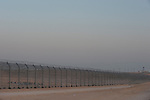 Eritrean immigrants are seen behind the newly-built fence in Israel-Egypt border, after they arrived a week earlier at the spot, crossed the old fence but got trapped by the new one. An Egyptian army outpost is seen in distance. Israeli soldiers have been providing the group with water, but not allowing them into Israel.<br /> After eight days, Israeli government allowed entrance for two women and one youth, while the rest of men returned into Egyptian soil.