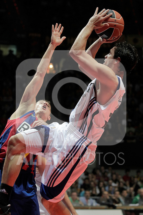 Real Madrid's Sergio LLull (r) and FC Barcelona's Jaka Lakovic during ACB Supercup Semifinal match.September 24,2010. (ALTERPHOTOS/Acero)