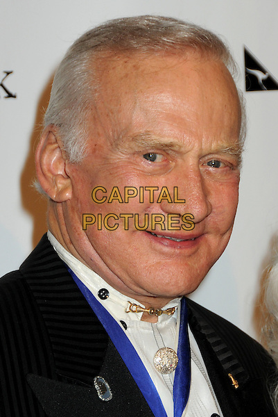 BUZZ ALDRIN .At the 7th Annual Living Legends of Aviation Awards held at the Beverly Hilton Hotel, Beverly Hills, California, USA, 22nd January 2010..portrait headshot  blue medal black white gold clasp collar .CAP/ADM/BP.©Byron Purvis/Admedia/Capital Pictures