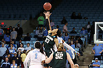 25 March 2014: Michigan State's Aerial Powers (23, green) and North Carolina's Diamond DeShields (23, white) challenge for the opening tipoff. The University of North Carolina Tar Heels played the Michigan State University Spartans in an NCAA Division I Women's Basketball Tournament First Round game at Cameron Indoor Stadium in Durham, North Carolina. UNC won the game 62-53.