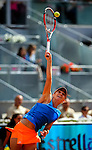 "Romanian tennis player Simona Halep serves against Russian tennis player Maria Sharapova during their women's singles final tennis match at the Madrid Masters at the ""Caja Magica"" sports complex in Madrid on May 11, 2014.<br /> <br /> Photocall3000/Daniel Calleja"