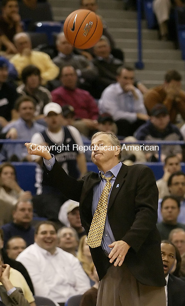 HARTFORD, CT, 01/17/08- 011708BZ16- UConn head coach Jim Calhoun hits the ball up in the air in frustration after Doug Wiggins (3) lost the ball  out of bounds during their game against Providence at the XL Center in Hartford Thursday night.<br /> Jamison C. Bazinet Republican-American