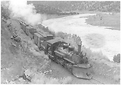 Elevated trackside view of K-28 #473 with northbound train #426 just south of Otowi bridge.<br /> D&amp;RGW  s. of Otowi, NM  Taken by Perry, Otto C. - 7/26/1941