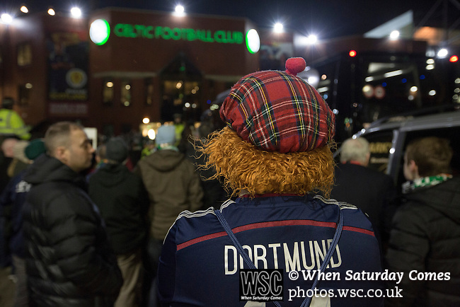 Scotland 1 Republic of Ireland 0, 14/11/2014. Celtic Park, European Championship qualifying. A home fan wearing a tartan Jimmy wig outside the stadium before the European Championship qualifying match between Scotland and the Republic of Ireland at Celtic Park, Glasgow. Scotland won the match by one goal to nil, scored by Shaun Maloney 16 minutes from time. The match was watched by 55,000 at Celtic Park, the venue chosen to host the match due to Hampden Park's unavailability following the 2014 Commonwealth Games. Photo by Colin McPherson.