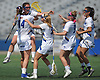 Carlee Ancona #5 of Hofstra University, second from left, gets mobbed by teammates after assisting on a goal by Drew Shapiro #3 that broke a 12-12 tie in the second half of a CAA women's lacrosse game against Towson at Shuart Stadium in Hempstead, NY on Sunday, April 16, 2017. Hofstra held the lead for the remainder of the match and won by a score of 17-15.