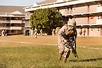 October 22, 2014. Camp LeJeune, North Carolina.<br />  Cpl. Raquel Mathieu runs with a M27 Infantry Automatic Rifle during patrol training for the 3rd Platoon of the Ground Combat Element Integrated Task Force. Marines in 3rd Platoon of the GCEITF are all considered provisional infantrymen as they have not been to the School of Infantry (SOI) previous to volunteering for the GCEITF.<br />  The Ground Combat Element Integrated Task Force is a battalion level unit created in an effort to assess Marines in a series of physical and medical tests to establish baseline standards as the Corps analyze the best way to possibly integrate female Marines into combat arms occupational specialities, such as infantry personnel, for which they were previously not eligible. The unit will be comprised of approx. 650 Marines in total, with about 400 of those being volunteers, both male and female. <br />  Jeremy M. Lange for the Wall Street Journal<br /> COED