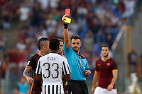 Calcio, Serie A: Roma vs Juventus. Roma, stadio Olimpico, 30 agosto 2015.<br /> Referee Nicola Rizzoli shows a red card to Juventus&rsquo; Patrice Evra during the Italian Serie A football match between Roma and Juventus at Rome's Olympic stadium, 30 August 2015.<br /> UPDATE IMAGES PRESS/Riccardo De Luca