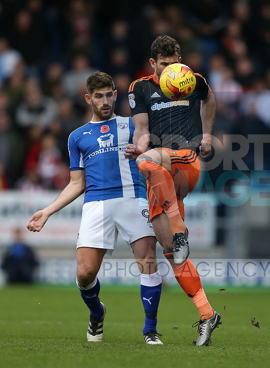 Jake Wright of Sheffield Utd  gets in front of Ched Evans of Chesterfield during the English League One match at the Proact Stadium, Chesterfield. Picture date: November 13th, 2016. Pic Simon Bellis/Sportimage