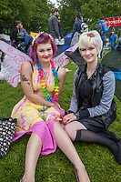 Two girlfriends wearing wings, Northwest Folklife Festival 2016, Seattle Center, Washington, USA.