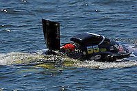 "Frame 5: Jay Gignac, GNH-55 ""Gi Wizz"" returns to the pits with the left sponson blown out and damage to the right.  (Grand National Hydroplane(s)"