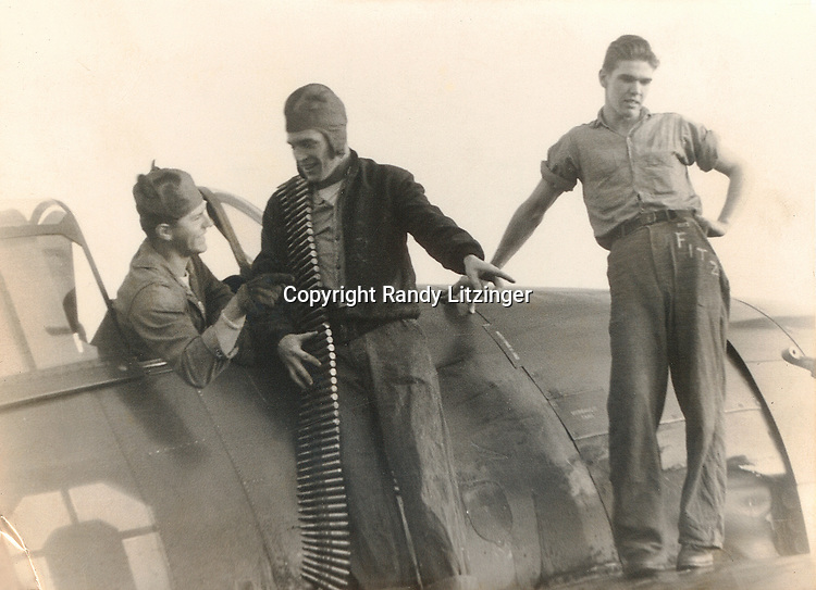 Robert Hanna, John 'Jack' Fogarty, and Marshall 'Fitz' Kuhn by a Curtiss SB2C-4 Helldiver plane on the U.S.S Shangri-La (CV-38) - 1944 or 1945  <br /> <br /> -- Photo By Wade Litzinger