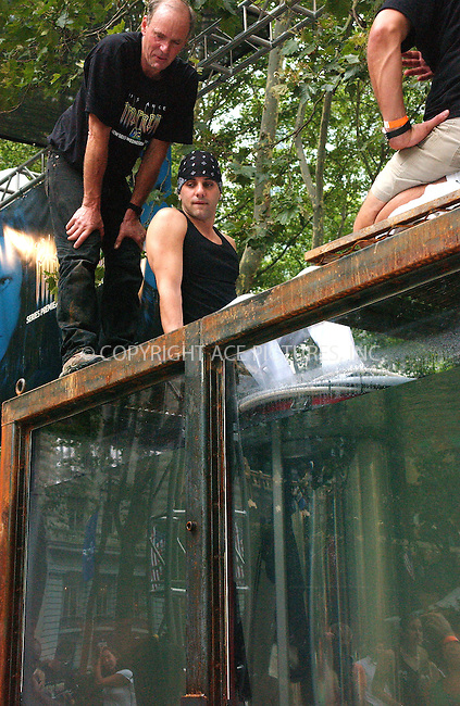 WWW.ACEPIXS.COM . . . . . ....NEW YORK, JULY, 18 2005 ....Criss Angel attempts his latest escape 'Oasis' where he will try to free himself before his oxygen runs out.  Bryant Park.....Please byline: KRISTIN CALLAHAN - ACE PICTURES.. . . . . . ..Ace Pictures, Inc:  ..Craig Ashby (212) 243-8787..e-mail: picturedesk@acepixs.com..web: http://www.acepixs.com
