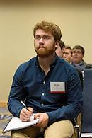 Taking notes at a seminar.