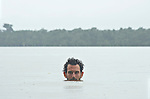 The Marowijne River, Suriname.  Author Andrew Westoll swimming with piranhas during a rainstorm.