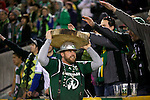 March 3, 2013; Portland, OR, USA; Portland Timbers mascot Timber Joey carries a slab of wood on his head which represents the Timbers' second goal against the New York Red Bulls in the second half at Jeld-Wen Field.  Mandatory Credit: Jaime Valdez-USA TODAY Sports