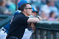 Charlotte Knights trainer Josh Fallin watches the action from the dugout during the game against the Indianapolis Indians at BB&T BallPark on April 27, 2019 in Charlotte, North Carolina. The Indians defeated the Knights 8-4. (Brian Westerholt/Four Seam Images)