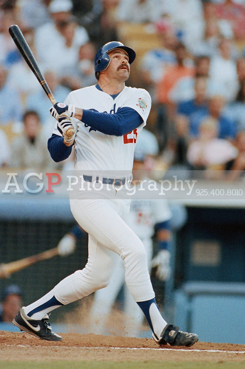 Jun 02, 1990 - Los Angeles, California, United States - Kirk Gibson of the Los Angeles Dodgers follows through on a swing at Dodger Stadium in Los Angeles June, 2, 1990. Gibson is a former Major League Baseball player, best known for his clutch home run in Game 1 of the 1988 World Series. He was named the National League MVP in 1988. .(Credit Image: © Alan Greth)