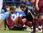 Anton Ferdinand of West Ham shouts out as he sits injured during the Premier League match at the Reebok Stadium, Bolton. Picture date 12th April 2008. Picture credit should read: Simon Bellis/Sportimage