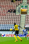 Wigan Athletic 1 Shrewsbury Town 0, 21/11/2015. DW Stadium, League One. The DW Stadium. Wigan Athletic earned a narrow 1-0 at home to Shrewsbury Town. Wigan competed in the Premier League from 2005 to 2013. They won the 2013 FA Cup. The club also embarked on its first European campaign during the 2013–14 UEFA Europa League. A young Shrewsbury fan waving a scarf.  Photo by Paul Thompson