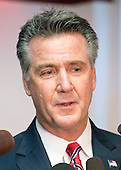 Washington Redskins general manager Bruce Allen meets reporters informally following the press conference where Jay Gruden was introduced as the new head coach of the Washington Redskins at Redskins Park in Ashburn, Virginia on Thursday, January 9, 2014<br /> Credit: Ron Sachs / CNP