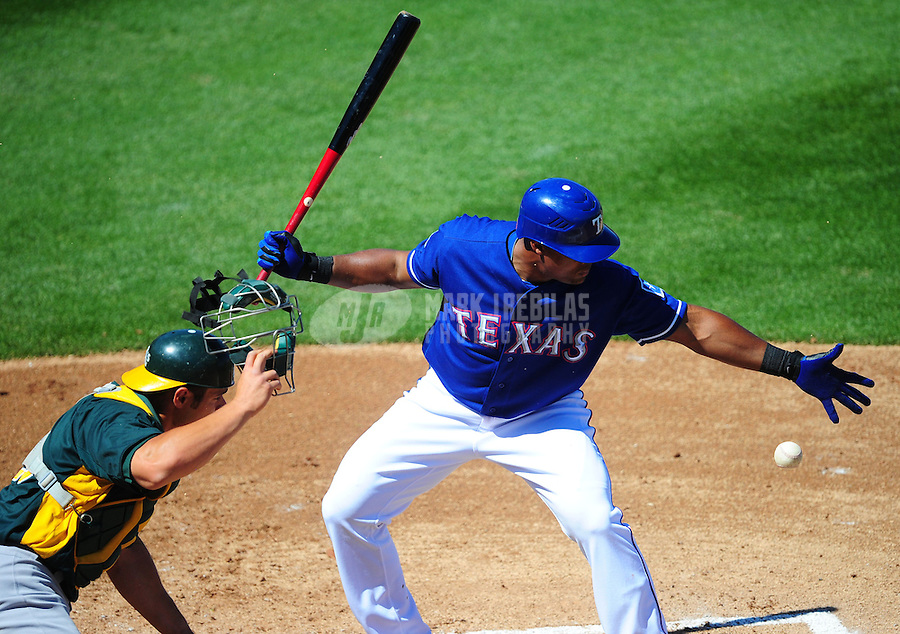 Mar. 15, 2012; Surprise, AZ, USA; Texas Rangers batter Adrian Beltre reaches for a foul ball in the first inning against the Oakland Athletics at Surprise Stadium.  Mandatory Credit: Mark J. Rebilas-