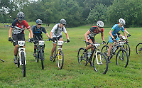 NWA Democrat-Gazette/MICHAEL WOODS &bull; @NWAMICHAELW<br /> Mountain bike race competitors Cole Anderson (from left) Joshua Pottridge, Garrett Lampson, Austin Morris, John Drummond get started in their race in the 17-19 division during the 19 and under Mountain Bike Championships at Slaugther Pen in Bentonville Saturday August 8, 2015. The event sponsored by the Bentonville Parks and Recreation Department,  is an exhibition this year as the new National Interscholastic Cycling Association works to set up its local league. It will be a competitive championship event in the future for ages 6-19.