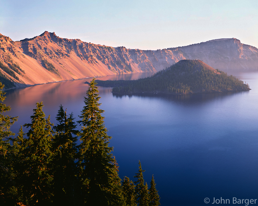 ORCL_073 - USA, Oregon, Crater Lake National Park, Sunrise on west rim of Crater Lake with Hillman Peak (left) and Llao Rock (right) overlooking Wizard Island.
