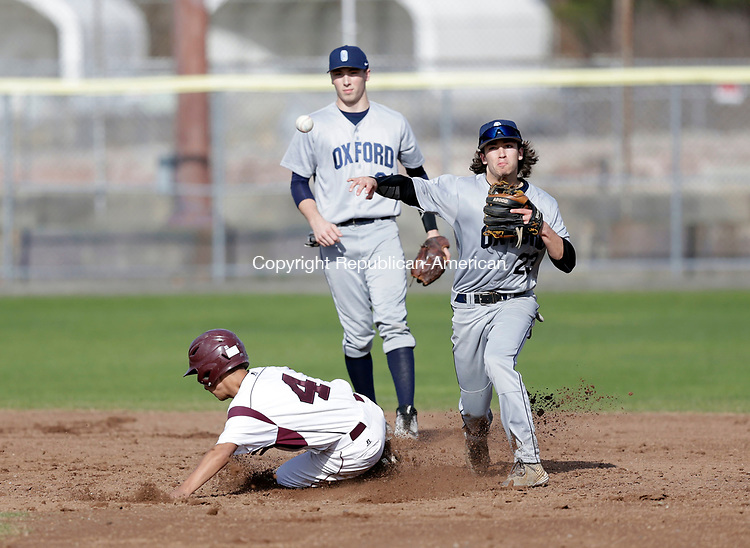 Torrington, CT- 12 April 2017-041217CM06- After getting Torrington's Aaron Bainer out at second, Oxford's Quinn Hillman throws to first as teammate Tom Davis backs him up during their NVL baseball matchup on Wednesday.    Christopher Massa Republican-American