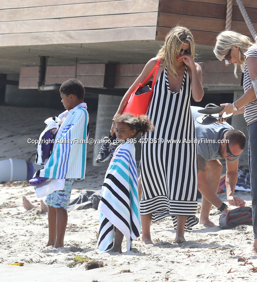 May 19th 2013<br /> <br /> Heidi Klum at the beach behind Nobu sushi restaurant with her boyfriend Martin Kristen<br /> Henry , Seven, Samuel . Heidi was wearing a black and white stripped zebra dress &amp; she almost had a wardrobe malfunction but quickly grabbed her breast before the wind blew it. No body fat for Heidi you could see her back bones. Heidi was carrying her kid and let her pick up a penny on the ground showing off her butt &amp; bright pink purse bag <br /> <br /> AbilityFilms@yahoo.com<br /> 805 427 3519 <br /> www.AbilityFilms.com