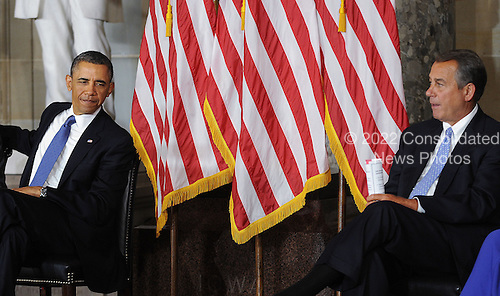 United States President Barack Obama, left, and Speaker of the U.S. House John Boehner (Republican of Ohio), right, look on during the unveiling of a statue of Rosa Parks in Statuary Hall of the United States Capitol February 27, 2013 in Washington, DC. .Credit: Olivier Douliery / Pool via CNP